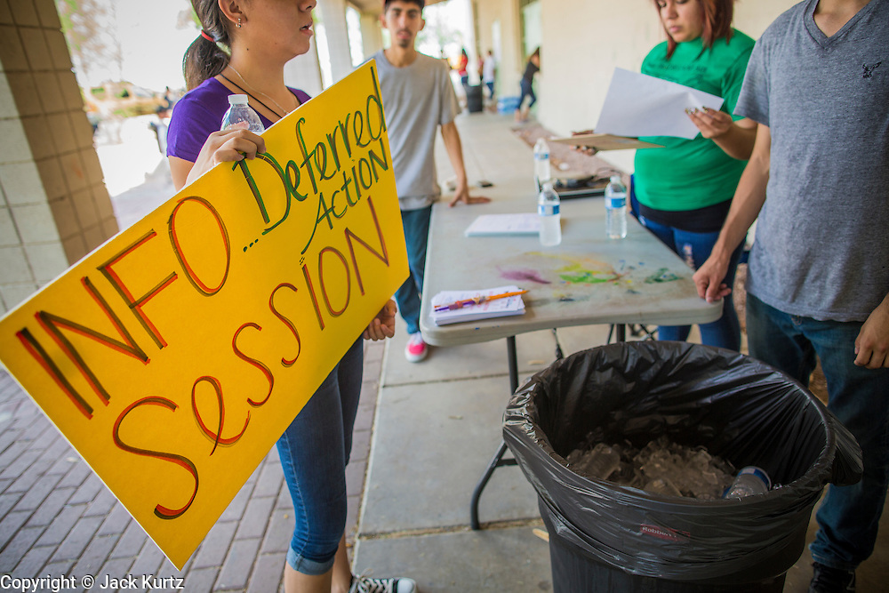 "18 AUGUST 2012 - PHOENIX, AZ: Volunteers set up signs for a deferred action workshop in Phoenix. More than 1000 people attended a series of 90 minute workshops in Phoenix Saturday on the ""deferred action"" announced by President Obama in June. Under the plan, young people brought to the US without papers, would under certain circumstances, not be subject to deportation. The plan mirrors some aspects the DREAM Act (acronym for Development, Relief, and Education for Alien Minors), that immigration advocates have sought for years. The workshops were sponsored by No DREAM Deferred Coalition.  PHOTO BY JACK KURTZ"