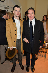 Left to right, TOM STURRIDGE and JOOLS HOLLAND at the charity Child Bereavement UK's 21st Anniversary Christmas Carol Concert held at Holy Trinity Brompton, London on 10th December 2015.