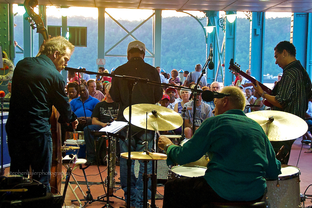 The last in the 2010 Friday night summer series of Jazz & Blues @ Dusk on the Hudson River waterfront at Yonkers Pier. Performance by Maciek Schejbal Quartet, with Mark Shim (sax), Dave Gilmore (guitar), Rene Hart (bass) and Maciek (drums).