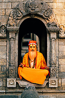 A Hindu sadhu poses for a photograph within the Shree Pashupatinath Temple grounds in Kathmandu.