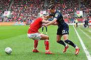 Jack Harrison (22) of Leeds United battles for possession with Bailey Wright (5) of Bristol City during the EFL Sky Bet Championship match between Bristol City and Leeds United at Ashton Gate, Bristol, England on 9 March 2019.