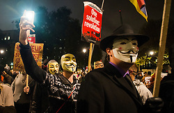 © Licensed to London News Pictures. 05/11/2015. London, UK. An anti-capitalist  protest organised by the group Anonymous outside Parliament in Westminster on bonfire night 05, November 2015. Bonfire night, also known as Guy Fawkes night, is an annual commemoration of when Guy Fawkes, a member of the Gunpowder Plot, was arrested for attempting to blow up the House of Lords at parliament.   Photo credit: Ben Cawthra/LNP