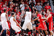 LOUISVILLE, KY - FEBRUARY 14: Officials try to break up a fight between the Louisville Cardinals and St. John's Red Storm during the game at KFC Yum! Center on February 14, 2013 in Louisville, Kentucky. Louisville defeated St. John's 72-58. (Photo by Joe Robbins)