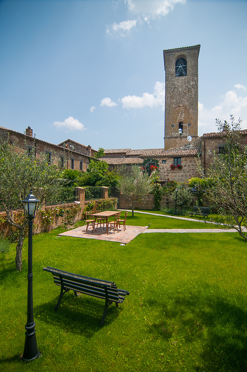 A garden of a house of the village of Civita di Bagnoregio.<br /> Civita di Bagnoregio is a town in the Province of Viterbo in central Italy, a suburb of the comune of Bagnoregio, 1 kilometre (0.6 mi) east from it. It is about 120 kilometres (75 mi) north of Rome. Civita was founded by Etruscans more than 2,500 years ago. Bagnoregio continues as a small but prosperous town, while Civita became known in Italian as La citt&agrave; che muore (&quot;The Dying Town&quot;). Civita has only recently been experiencing a tourist revival. The population today varies from about 7 people in winter to more than 100 in summer.The town was placed on the World Monuments Fund's 2006 Watch List of the 100 Most Endangered Sites, because of threats it faces from erosion and unregulated tourism.