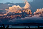 PRICE CHAMBERS / NEWS&amp;GUIDE<br /> Morning sunlight hits the Tetons as clouds surrounding the peaks begin to disperse.