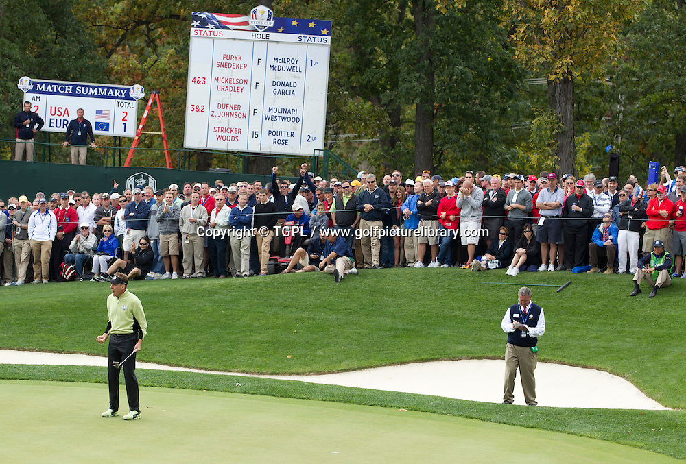 Ian POULTER (ENG) makes birdie putt at 16th par 4 V Tiger WOODS (US) and Steve STRICKER (US) during morning Foursomes,Ryder Cup Matches,Medinah CC,<br /> Medinah,Illinois,USA.