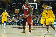 CLEVELAND, OH - MARCH 20: LeBron James #6 of the Miami Heat drives past Alonzo Gee #33 during the first half at Quicken Loans Arena on March 20, 2013 in Cleveland, Ohio. NOTE TO USER: User expressly acknowledges and agrees that, by downloading and or using this photograph, User is consenting to the terms and conditions of the Getty Images License Agreement. (Photo by Jason Miller/Getty Images) *** Local Caption *** LeBron James; Alonzo Gee