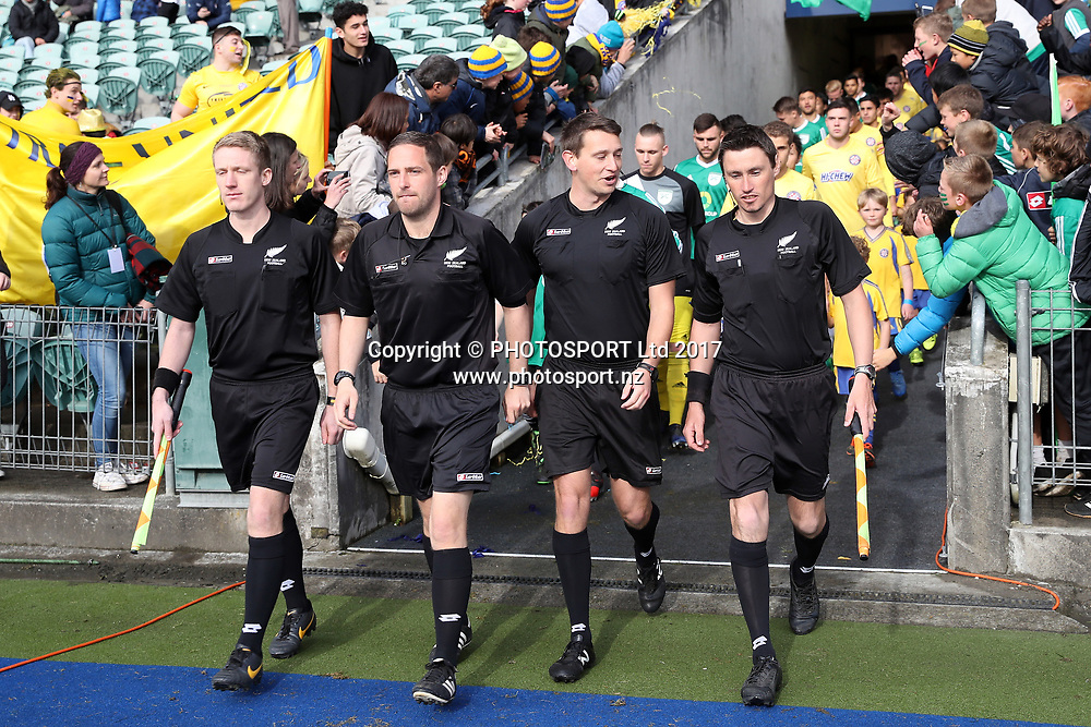 Referees lead the teams out. ISPS Handa Chatham Cup Final 2017, Central United v Onehunga Sports, QBE Stadium Auckland, Sunday 10th September 2017. Copyright Photo: Shane Wenzlick