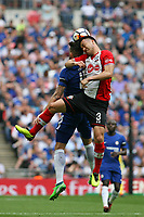 Football - 2017 / 2018 FA Cup - Semi Final: Chelsea vs. Southampton<br /> <br /> Southampton's Maya Yoshida wins a header from Olivier Giroud of Chelsea at Wembley Stadium <br /> <br /> COLORSPORT/SHAUN BOGGUST