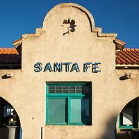 USA, New Mexico, Santa Fe, Setting sun lights train platform and Santa Fe Depot Station