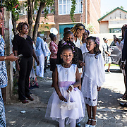 A cortege of bridesmaid is about to make their entry in the church for a DR Congolese wedding in Yeoville. 20 November 2016. Johannesburg, South Africa. © Miora Rajaonary