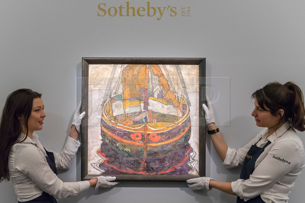 """© Licensed to London News Pictures. 20/02/2019. LONDON, UK. Technicians hold """"Triestiner Fischerboot (Trieste Fishing Boat"""", 1912, by Egon Schiele (Est. £6.0-8.0m).  Preview of Sotheby's Impressionist & Modern and Surrealist Art sales.  The auction will take place at Sotheby's New Bond Street on 26 February 2019.  Photo credit: Stephen Chung/LNP"""