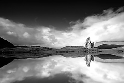 The ruins of Ardvreck Castle reflected in the waters of Loch Assynt