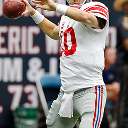 October 10, 2010; Houston, TX USA; New York Giants quarterback Eli Manning (10) throws a pass during warms ups prior to kickoff of a game against the Houston Texans at Reliant Stadium. The Giants defeated the Texans 34-10. Mandatory Credit: Derick E. Hingle