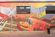 One of the many public art murals in an alley next to Enzio's Italian Kitchen in the Old Town historic shopping and restaurant district in Fort Collins, Colorado.