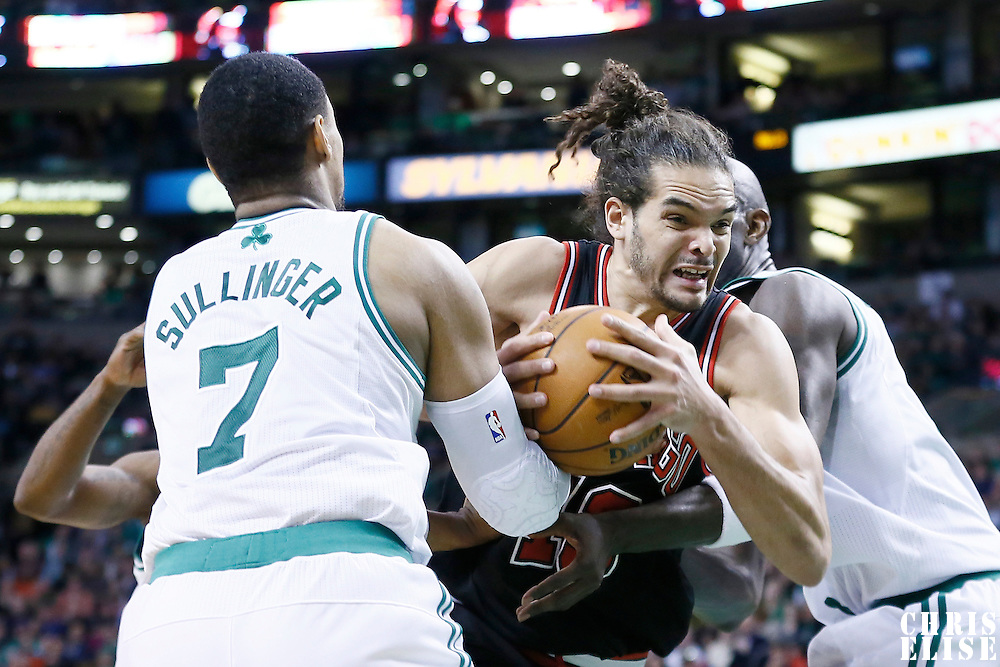 18 January 2013: Chicago Bulls center Joakim Noah (13) drives past Boston Celtics power forward Jared Sullinger (7) and Boston Celtics power forward Kevin Garnett (5) during the Chicago Bulls 100-99 overtime victory over the Boston Celtics at the TD Garden, Boston, Massachusetts, USA.