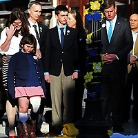 (Boston, MA - 4/15/15) Martin Richard's parents, Denise and Bill, and siblings Jane and Henry, stand with Mayor Martin Walsh after unveiling One Boston banners in front of what had been the Forum restaurant on Boylston Street at the site of one of the Boston Marathon blasts, which killed Martin two years ago, Wednesday, April 15, 2015. Staff photo by Angela Rowlings.