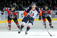 KELOWNA, CANADA, OCTOBER 29: JC Lipon #34 of the Kamloops Blazers skates on the ice with Cody Chikie #14 and Madison #4 of the Kelowna Rockets in pursuit as the Kamloops Blazers visit the Kelowna Rockets  on October 29, 2011 at Prospera Place in Kelowna, British Columbia, Canada (Photo by Marissa Baecker/Shoot the Breeze) *** Local Caption *** JC Lipon; Cody Chikie; Madison Bowey;