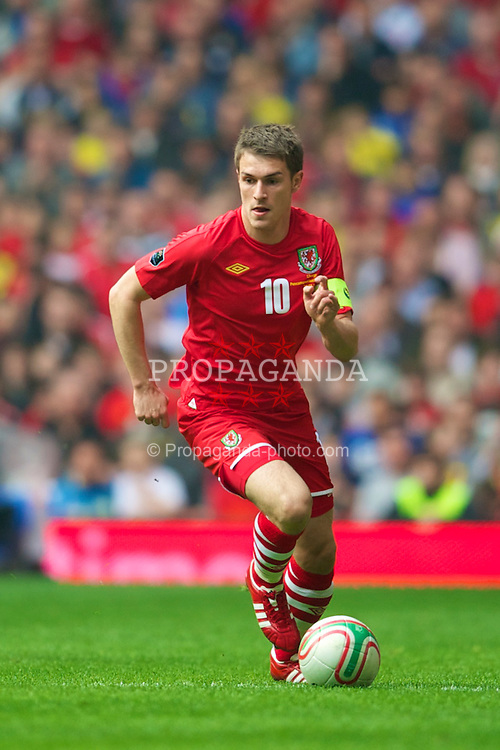 CARDIFF, WALES - Saturday, March 26, 2011: Wales' captain Aaron Ramsey in action against England during the UEFA Euro 2012 qualifying Group G match at the Millenium Stadium.  (Photo by David Rawcliffe/Propaganda)