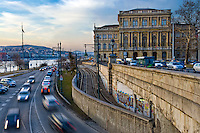 View of the Hungarian Academy of Science and street with motion car bording the Danube.