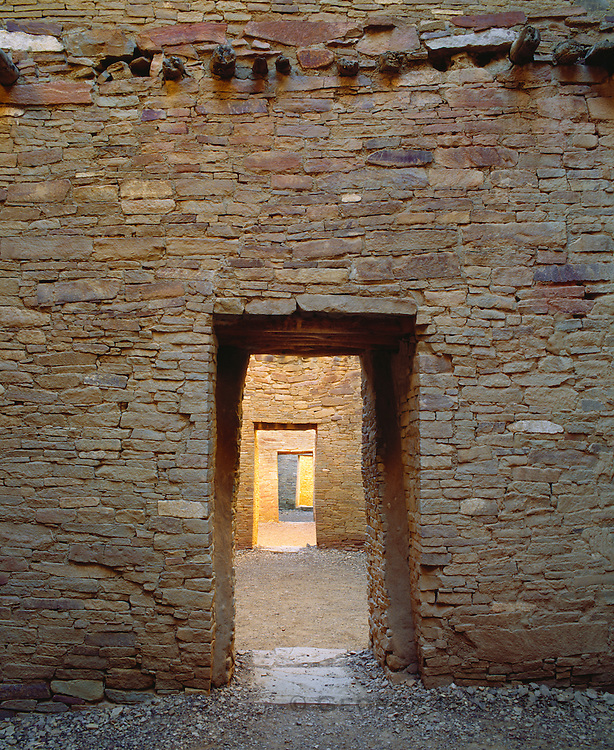 0204-1066B ~ Copyright: George H. H.Huey ~ Doorways, Pueblo Bonito. Anasazi 'great houses' pueblo, built A.D. 850-1130. [3 stories high, over 600 rooms]. Chaco Culture National Historical Park, New Mexico.