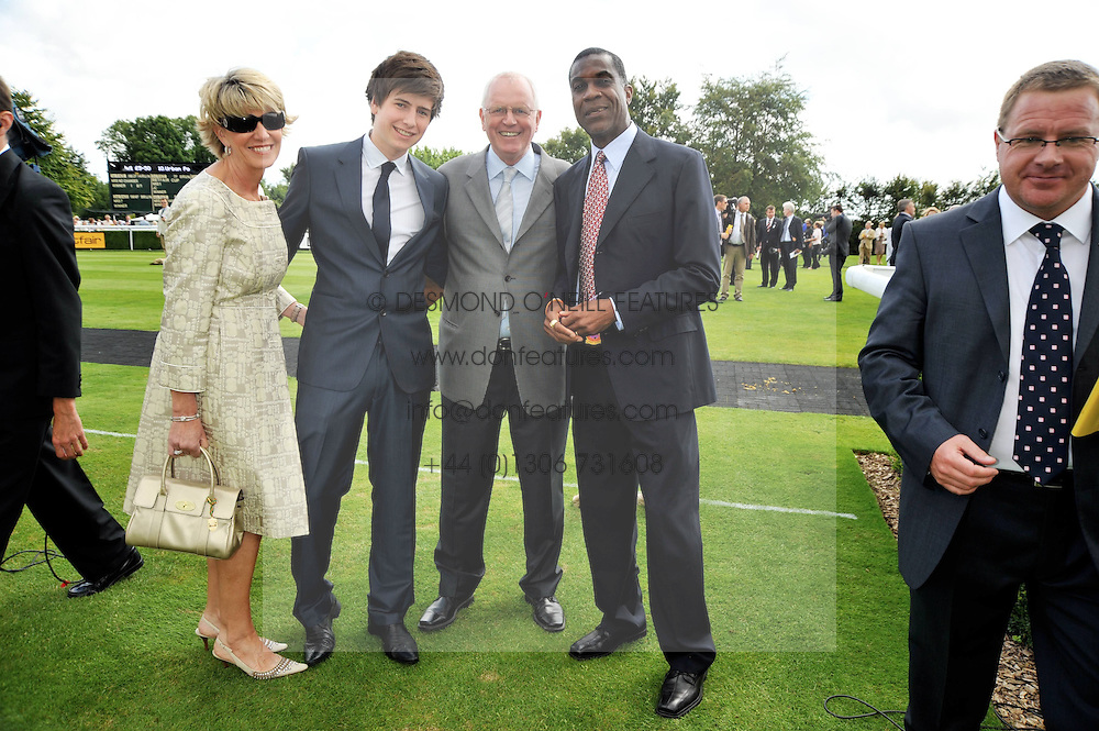 Trainer MICK CHANNON and his wife JILL, their son JACK CHANNON and West Indies cricket legend MICHAEL HOLDING at day 1 of the annual Glorious Goodwood racing festival held at Goodwood Racecourse, West Sussex on 28th July 2009.