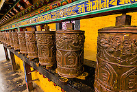 Prayer wheels near the Potala Palace, Lhasa, Tibet (Xizang, China).