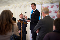 © Licensed to London News Pictures. 10/10/2013. London, UK. The deputy prime minister, Nick Clegg (C), talks to guests at a Parliamentary reception hosted by mental health charities 'Time to Change', 'Mind' and 'Rethink Mental Illness' in London today (10/10/2013). The event held on 'World Mental Health Day' saw the Deputy Prime Minister, Nick Clegg, and the Care and Support Minister, Norman Lamb, joined by cross party MP's and peers, reinforce the need to tackle the stigma and discrimination surrounding mental health problems.  Photo credit: Matt Cetti-Roberts/LNP
