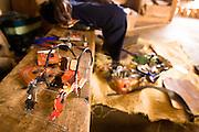 A man makes cars from recycled metal cans at the Village Artisanal de Ouagadougou, a cooperative that employs dozens of artisans who work in different mediums, in Ouagadougou, Burkina Faso, on Monday November 3, 2008.