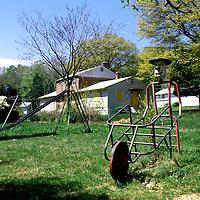 Playground equipment stands amid abandoned housing in Alexandria, VA.