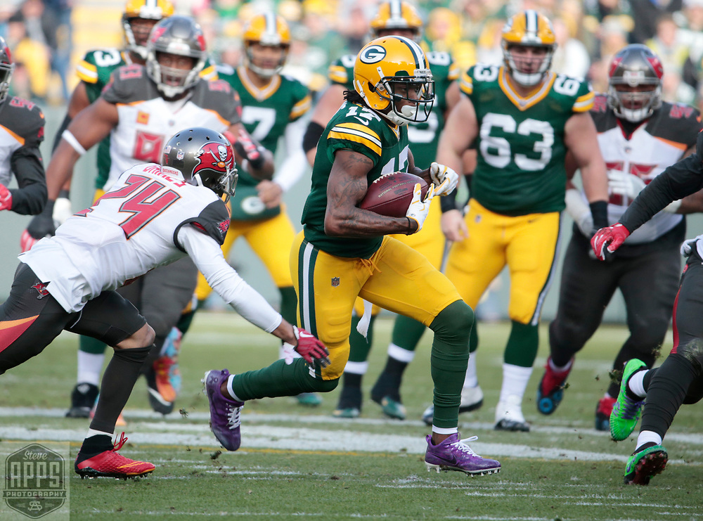 Green Bay Packers wide receiver Davante Adams (17) on a 13-yard catch in the 1st quarter. Tampa Bay Buccaneers cornerback Brent Grimes (24) makes the tackle. <br /> The Green Bay Packers hosted the Tampa Bay Buccaneers at Lambeau Field in Green Bay,  Sunday, Dec. 3, 2017.  STEVE APPS FOR THE STATE JOURNAL.