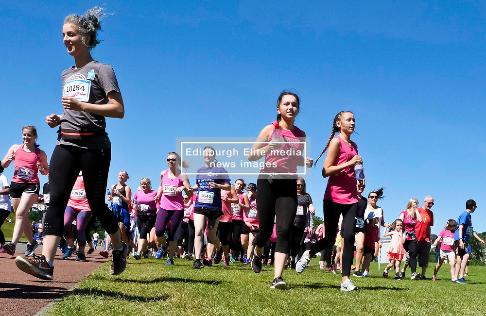Pictured: <br /> <br /> Two thousand people gathered in Holyrood Park Edinburgh for Cancer Reasearch'e Race for Life . The runmners, the majority of whom were women, took part in 5K and 10K events. ,<br /> <br /> Ger Harley   EEm 24 June 2018