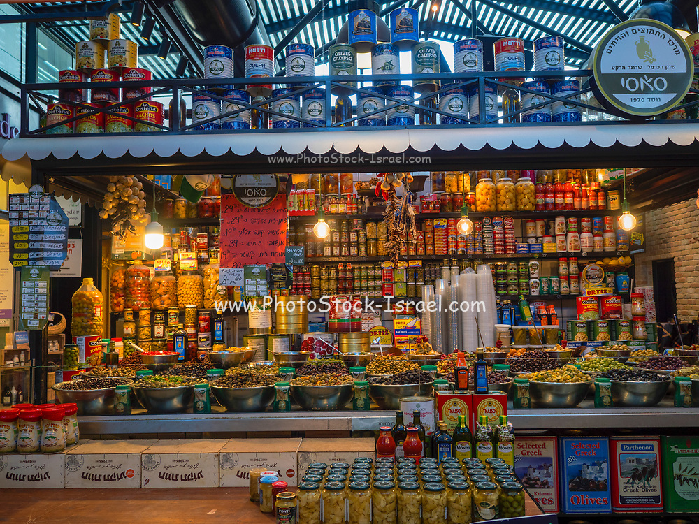 Delicatessen stall selling olives herbs and spices in Sarona Market, Tel Aviv, Israel