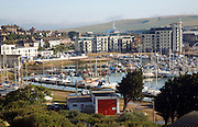 View over marina and town, Newhaven, East Sussex, England