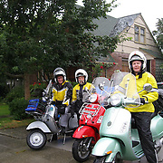 Doc, Ed and Chuck leaving Seattle in rain at start of Seattle to San Francisco scooter ride