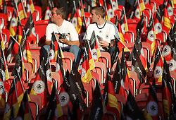GER, Commerzbank Arena, GER, Stuttgart, FSP, LS, Deutschland (GER) vs Brasilien (BRA), im Bild .. zwei Fans sitzen zwischen leeren Plätzen , auf denen Deutschland-Fahnen bereitliegen // durch the friendly ship between Germany (GER) vs Brasil (BRA) in Commerzbank Arena, Stuttgart, on 2011/08/11 EXPA Pictures © 2011, PhotoCredit: EXPA/ nph/  Hessland       ****** out of GER / CRO  / BEL ******