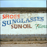 Hand painted advertisement  on a wall near the Camber Sands Beach and Holiday Park.