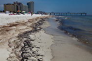 June 12, 2010, Orange Beach, Alabama, People on the beach as oil from the BP oil spill washes up on shore.