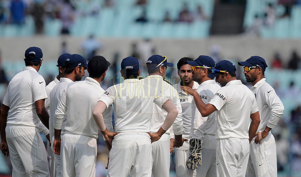 Bhuvneshwar Kumar of India along with teammates celebrates the wicket of Chris Gayle of West Indies during day one of the first test match between India and The West Indies held at The Eden Gardens Stadium in Kolkata, India on the 6th November 2013<br /> <br /> Photo by: Pal Pillai - BCCI - SPORTZPICS
