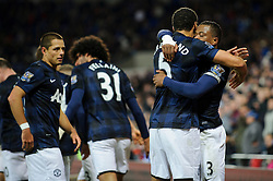 Man Utd Defender Patrice Evra (FRA) celebrates with Rio Ferdinand (ENG) after scoring a goal during the first half of the match - Photo mandatory by-line: Rogan Thomson/JMP - Tel: Mobile: 07966 386802 - 24/11/2013 - SPORT - FOOTBALL - Cardiff City Stadium - Cardiff City v Manchester United - Barclays Premier League.