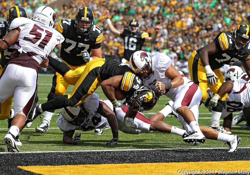 September 24, 2011: Iowa Hawkeyes running back Marcus Coker (34) is hit by Louisiana Monroe Warhawks safety Khairi Usher (3) as he runs 4 yards for a touchdown during the second quarter of the game between the Iowa Hawkeyes and the Louisiana Monroe Warhawks at Kinnick Stadium in Iowa City, Iowa on Saturday, September 24, 2011. Iowa defeated Louisiana Monroe 45-17.