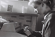 Student friend typing up an essay, Norwich, UK, 1986.