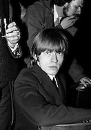 The Rolling Stones Charlie is my Darling - Ireland 1965..Brian Jones poses for the cameras at the Rolling Stones press conference at the Adelphi Theatre, Middle Abbey Street, Dublin. This was the band's first Irish tour of 1965...07/01/1965.01/07/1965.07 January 1965..The Rolling Stones Charlie is my Darling - Ireland 1965.Out November 2nd from ABKCO.Super Deluxe Box Set/Blu-ray and DVD Details Revealed. .ABKCO Films is proud to join in the celebration of the Rolling Stones 50th Anniversary by announcing exclusive details of the release of the legendary, but never before officially released film, The Rolling Stones Charlie is my Darling - Ireland 1965.  The film marked the cinematic debut of the band, and will be released in Super Deluxe Box Set, Blu-ray and DVD configurations on November 2nd (5th in UK & 6th in North America).. .The Rolling Stones Charlie is my Darling - Ireland 1965 was shot on a quick weekend tour of Ireland just weeks after ?(I Can't Get No) Satisfaction? hit # 1 on the charts and became the international anthem for an entire generation.  Charlie is my Darling is an intimate, behind-the-scenes diary of life on the road with the young Rolling Stones featuring the first professionally filmed concert performances of the band's long and storied touring career, documenting the early frenzy of their fans and the riots their live performances incited.. .Charlie is my Darling showcases dramatic concert footage - including electrifying performances of ?The Last Time,? ?Time Is On My Side? and the first ever concert performance of the Stones counterculture classic, ?(I Can't Get No) Satisfaction.?  Candid, off-the-cuff interviews are juxtaposed with revealing, comical scenes of the band goofing around with each other. It's also an insider's glimpse into the band's developing musical style by blending blues, R&B and rock-n-roll riffs, and the film captures the spark about to combust into The Greatest Rock and Roll Band in the World.. .The 1965 version of C