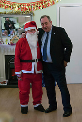 First Minister Alex Salmond, accompanied by Santa Clause (Arthur Martin), visited the Dean Club in Stockbridge Edinburgh today to distribute Christmas presents to the residents.  (c) GER HARLEY | StockPix.eu