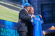 Apr 25, 2019; Nashville, TN, USA; Iowa tight end T.J. Hockenson poses with NFL commissioner Roger Goodell after being selected as the No. 8 pick of the first round by the Detroit Lions during the 2019 NFL Draft. (Kim Hukari/Image of Sport)