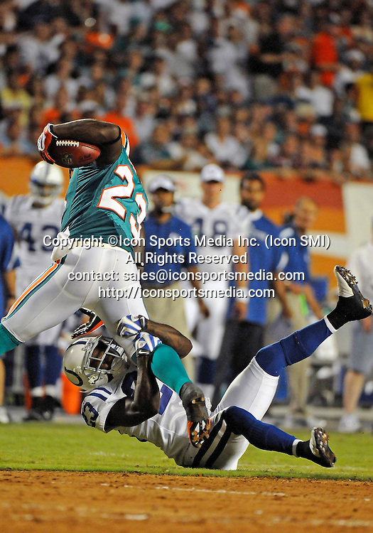 21 September 2009: Miami Dolphins running back Ronnie Brown (23) is tackled by Indianapolis  Colts safety Tim Jennings (23) in the Colts' 27-23 victory at Land Shark Stadium, Miami, Florida.