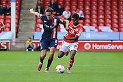 Mitchell Lund and Rico Henry tussle for the ball during the Sky Bet League 1 match between Walsall and Doncaster Rovers at the Banks's Stadium, Walsall, England on 12 September 2015. Photo by Alan Franklin.