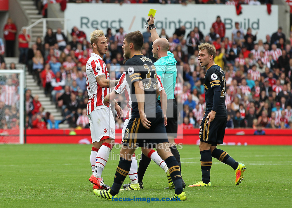 Marko Arnautovic of Stoke City is booked by referee Anthony Taylor during the Premier League match against Tottenham Hotspur at the Bet 365 Stadium, Stoke-on-Trent.<br /> Picture by Michael Sedgwick/Focus Images Ltd +44 7900 363072<br /> 10/09/2016