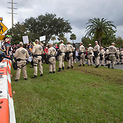 A heavy police presence is seen as protestors gather in the staging site prior to a Richard Spencer speech at the Phillips Center for the Performing Arts on the University of Florida campus in Gainesville, Florida on Thursday, October 18, 2017. (Alex Menendez)