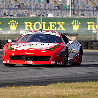 Team AIM Autosport Team FXDD Racing with Ferrari competing at the Rolex 24 at Daytona 2012